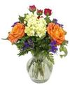 A 6.75in  glass vase holds an all around arrangement with two roses, a mini hydrangea, a spray rose, statice, and bupleurum. 13in H x 9in W
