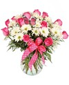A 7-3/4in H glass vase holds an all around arrangement of white daisy poms, a dozen pink roses, babies breath, a butterfly, and a pink polka dot bow. 18in H x 18in W